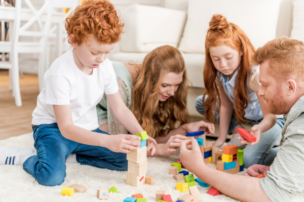 parents and children playing with toys